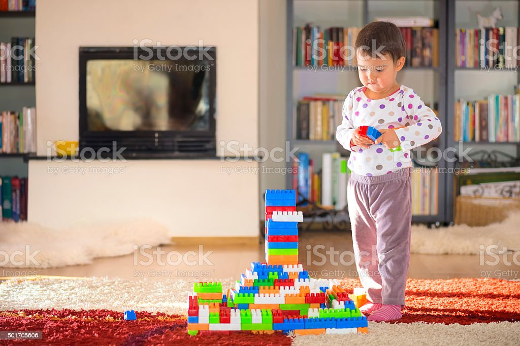Lovely laughing little child, brunette girl of preschool age playing...