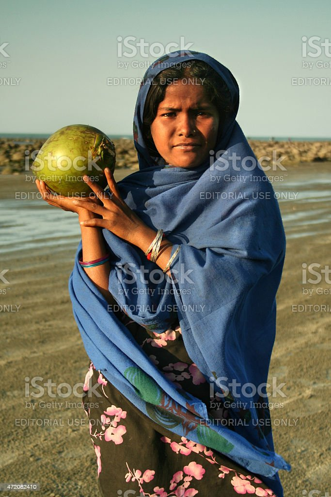 Girl offering coconut stock photo