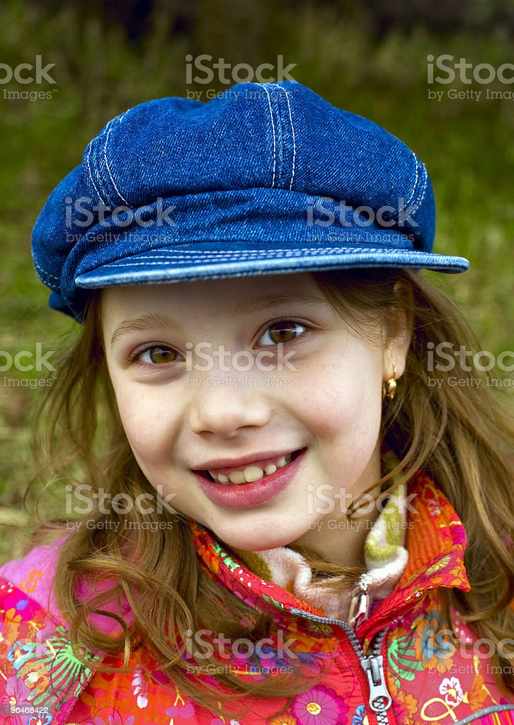 Girl on a background of the green grass royalty-free stock photo