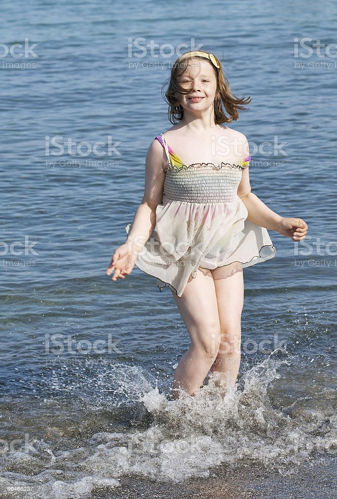 Girl on a background of the sea royalty-free stock photo