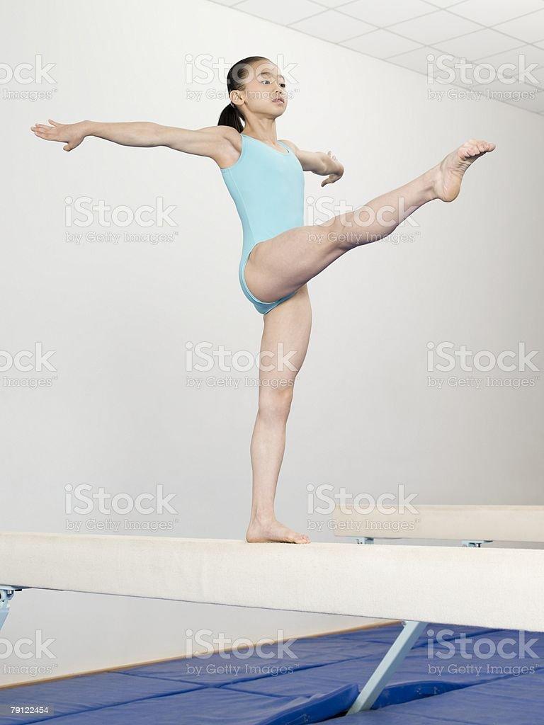 Girl on a balance beam 免版稅 stock photo