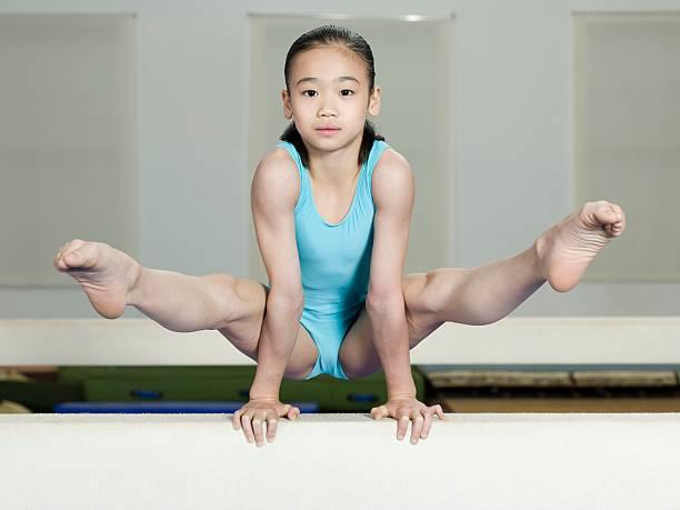 Girl on a balance beam stock photo