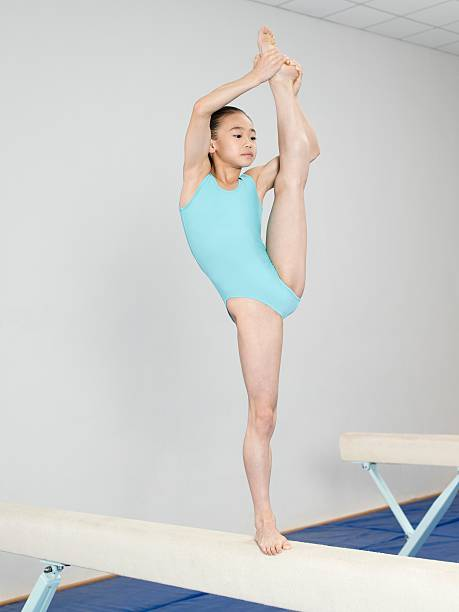 girl on a balance beam - leotard stock photos and pictures