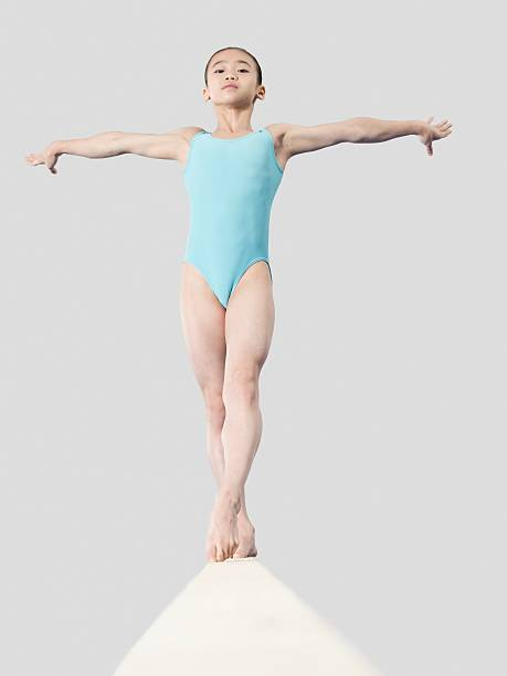 girl on a balance beam - balance beam stock photos and pictures