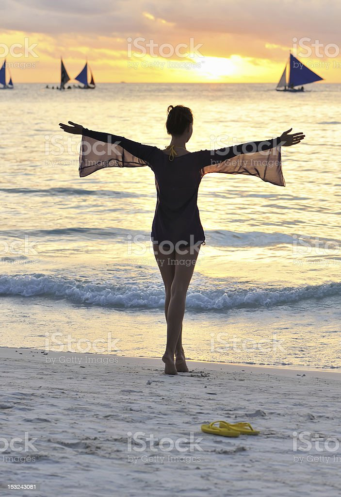 Girl on a beach at sunset royalty-free stock photo