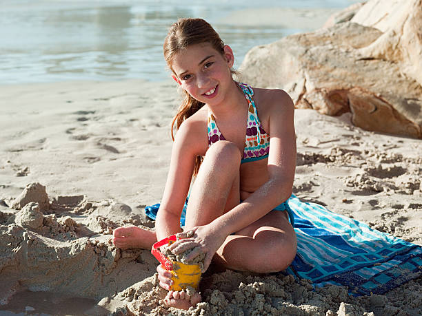 girl on a beach - girl alone in swimsuit stock photos and pictures