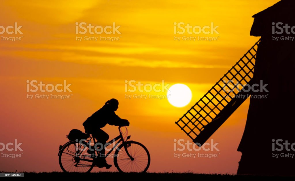 Girl on a bike in Dutch Setting stock photo