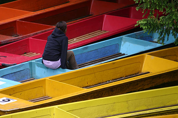 a girl on a boat - detachment stock pictures, royalty-free photos & images