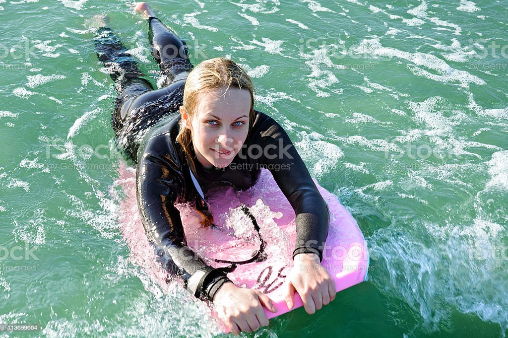 Girl on a boogieboard royalty-free stock photo