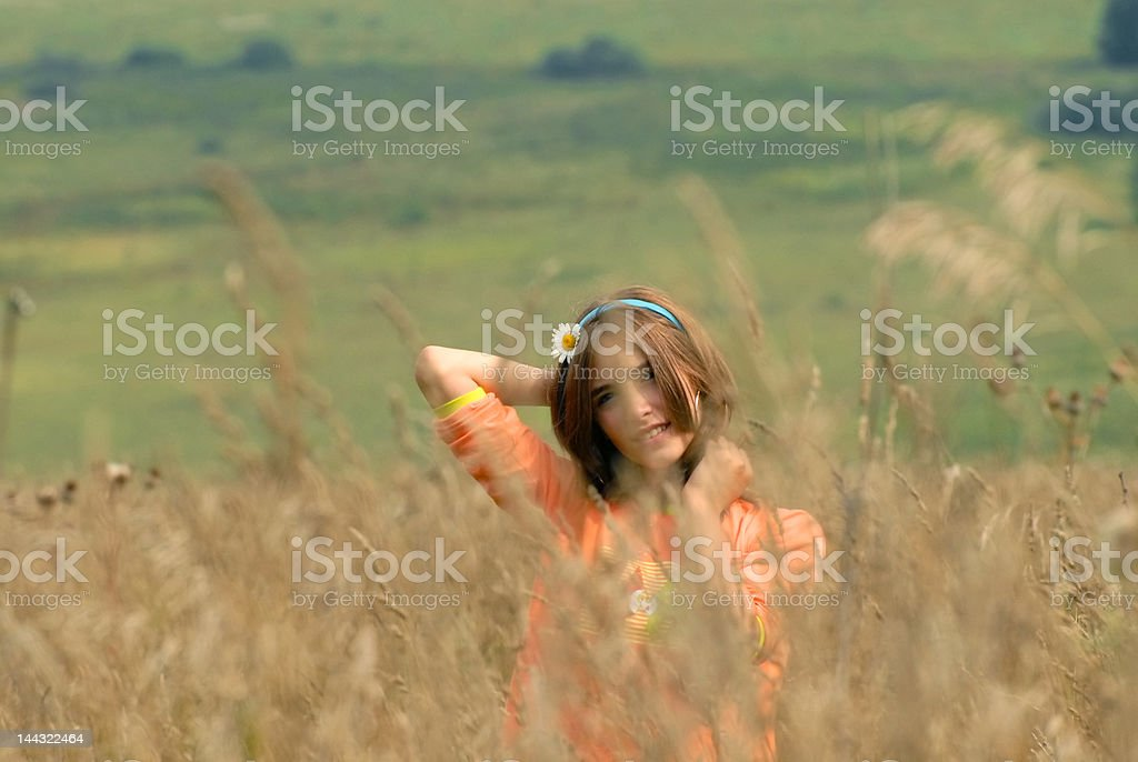 Girl on a meadow royalty-free stock photo