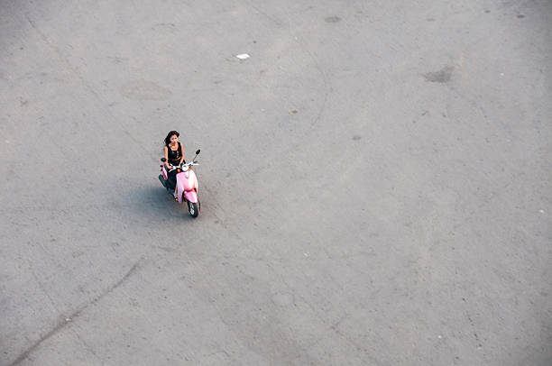 girl on a motorcycle at an empty road junction - motorbike, umbrella stock pictures, royalty-free photos & images