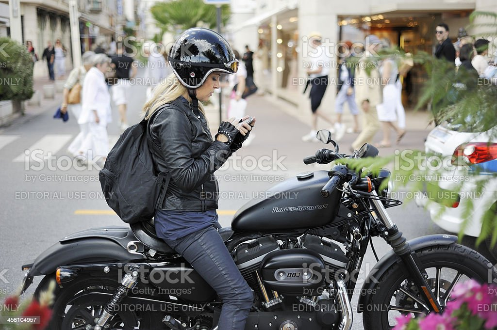 Girl on a Motorcycle at Cannes stock photo