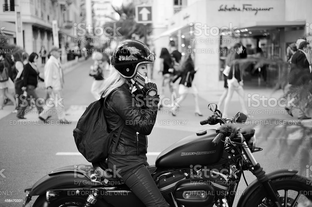 Girl on a Motorcycle at Cannes royalty-free stock photo