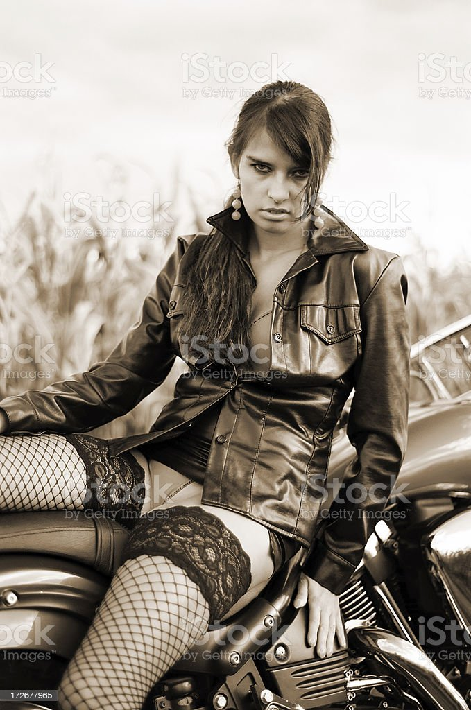 Girl on a motorcycle royalty-free stock photo
