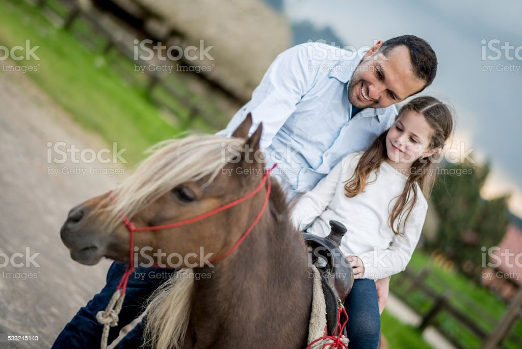 Girl on a pony stock photo