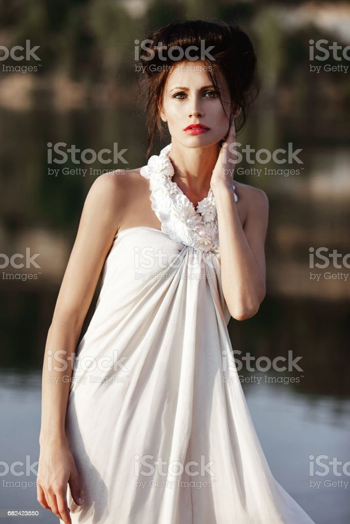 girl on a riverside in summer in beautiful nature royalty-free stock photo
