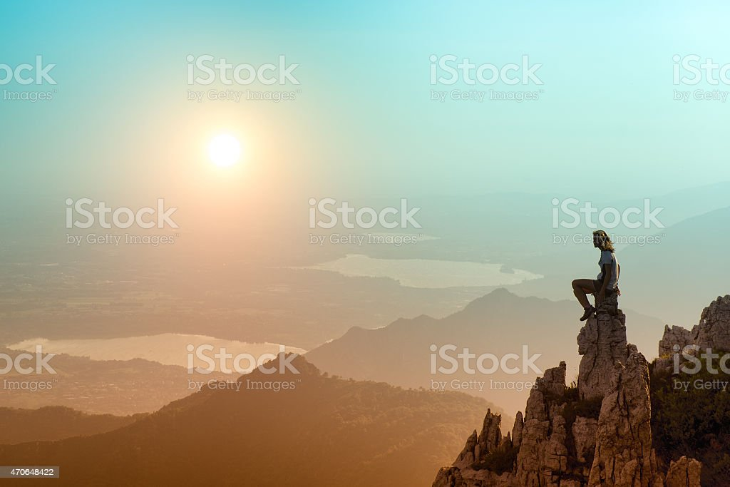 girl on a rock suns stock photo