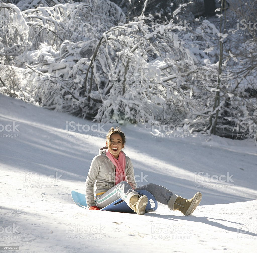 Girl on a sled royalty-free stock photo