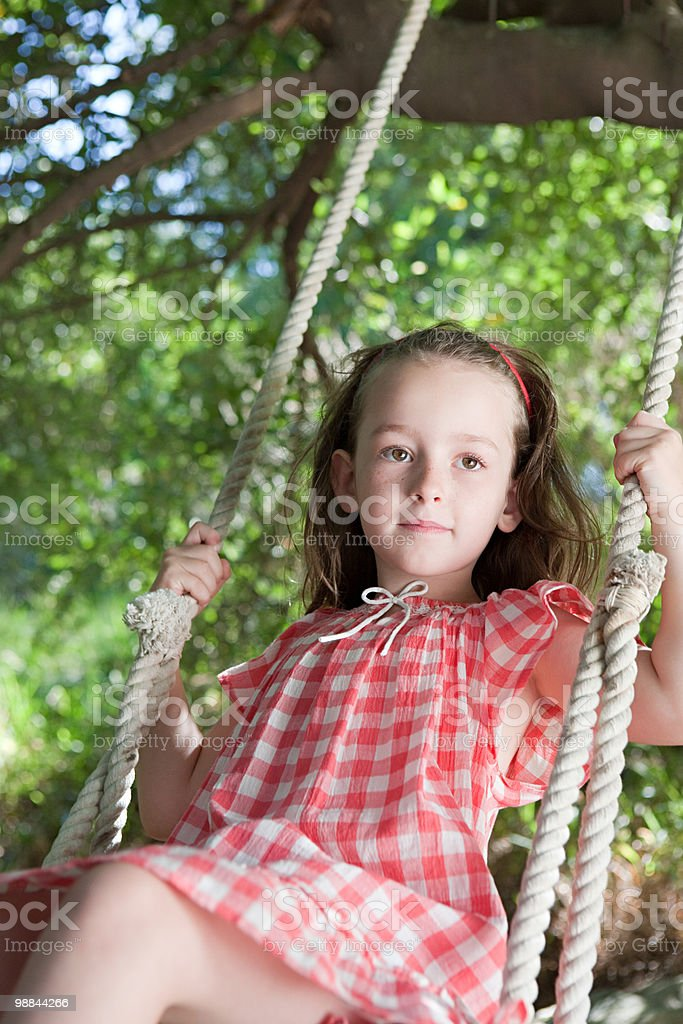 Girl on a swing 免版稅 stock photo