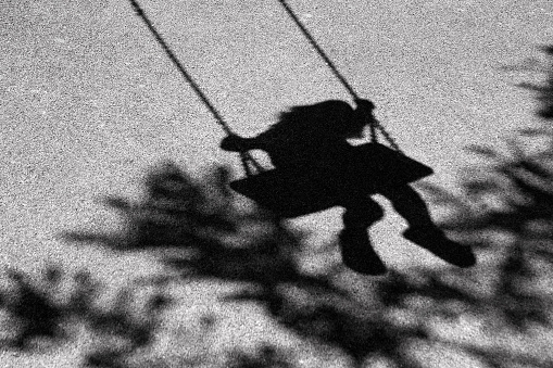 Girl on a swing shadow