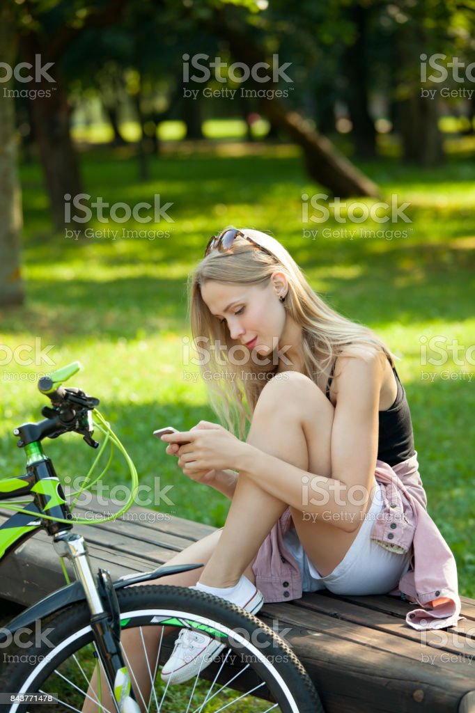 Girl on a walk with a mobile phone
