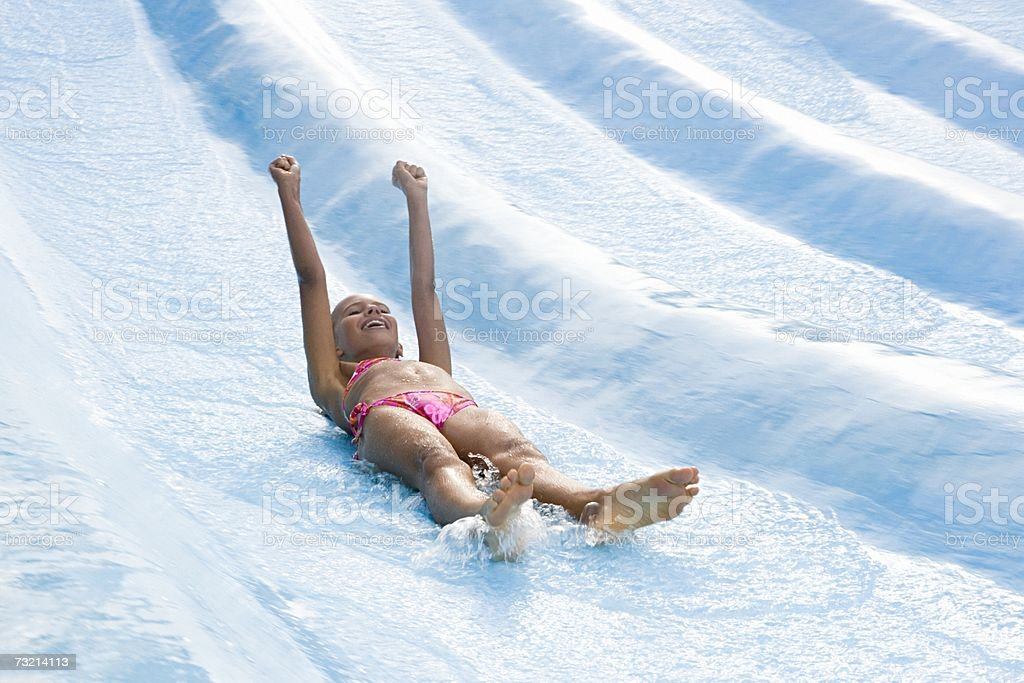 Girl on a water slide royalty-free stock photo