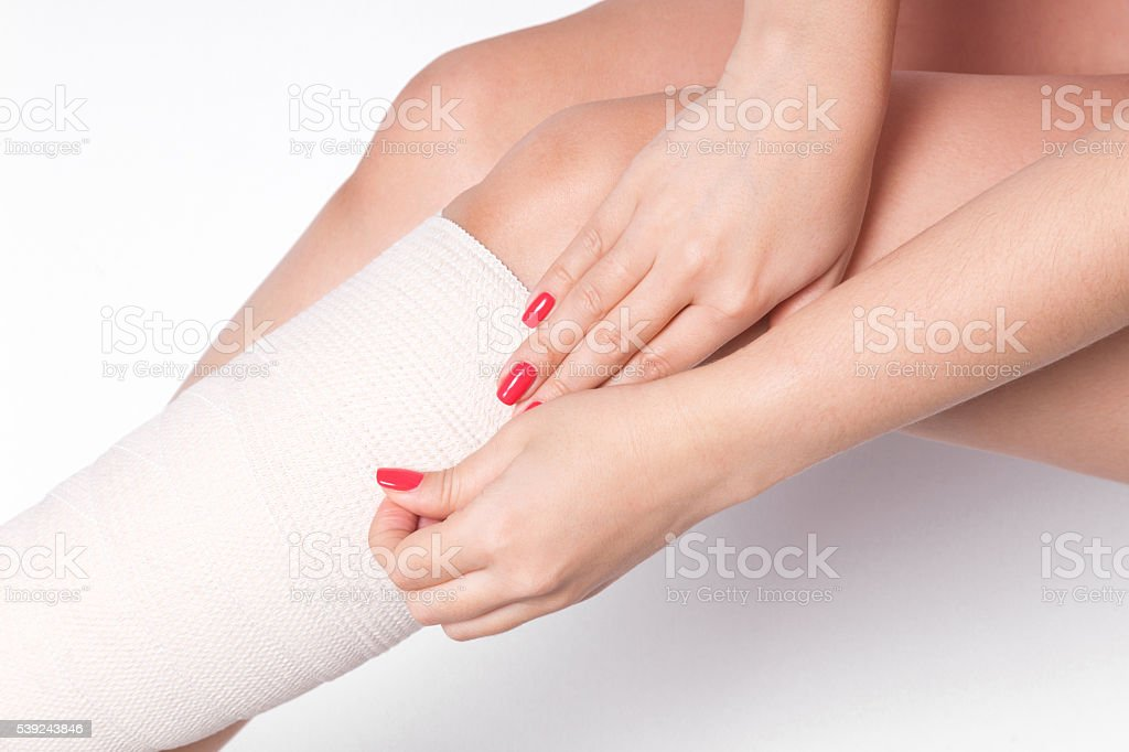 girl on a white background corrects an elastic bandage royalty-free stock photo