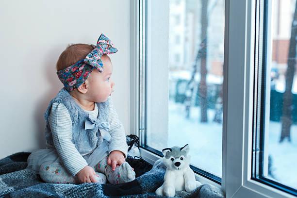 girl on a window sill - hunde strumpfhosen stock-fotos und bilder