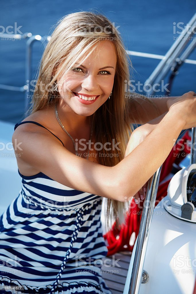 Girl on a yacht stock photo