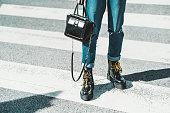 istock A girl on a zebra crosswalk, legs 1293372422