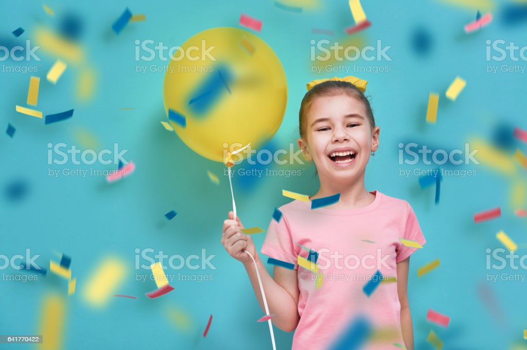 girl on background of bright blue wall stock photo