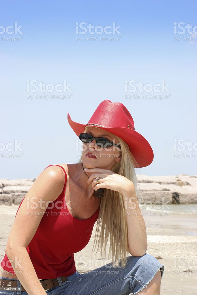 Girl on beach wearing red cowboy hat royalty-free stock photo