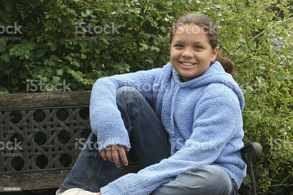 Girl on bench royalty-free stock photo