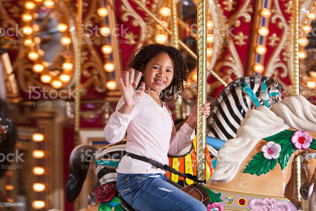 Girl on carousel royalty-free stock photo