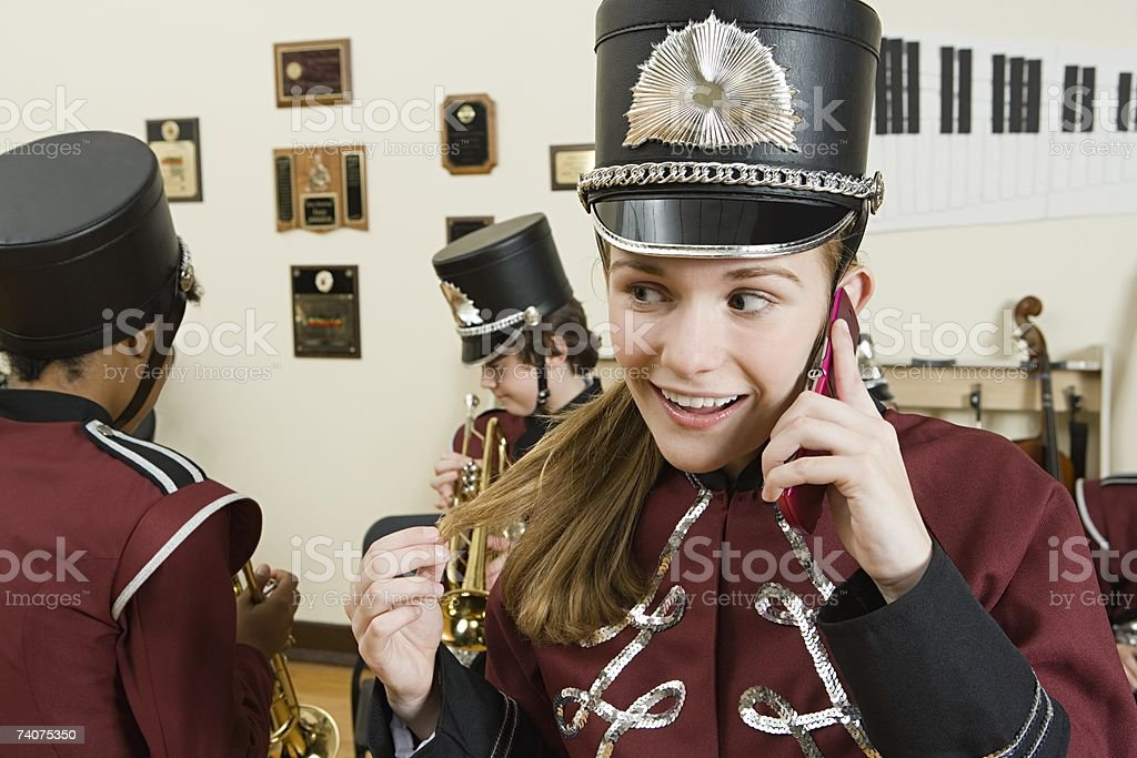 Girl on cellphone in band practice stock photo