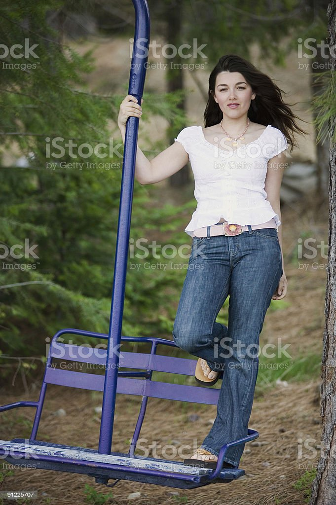Girl on chairlift swing royalty-free stock photo