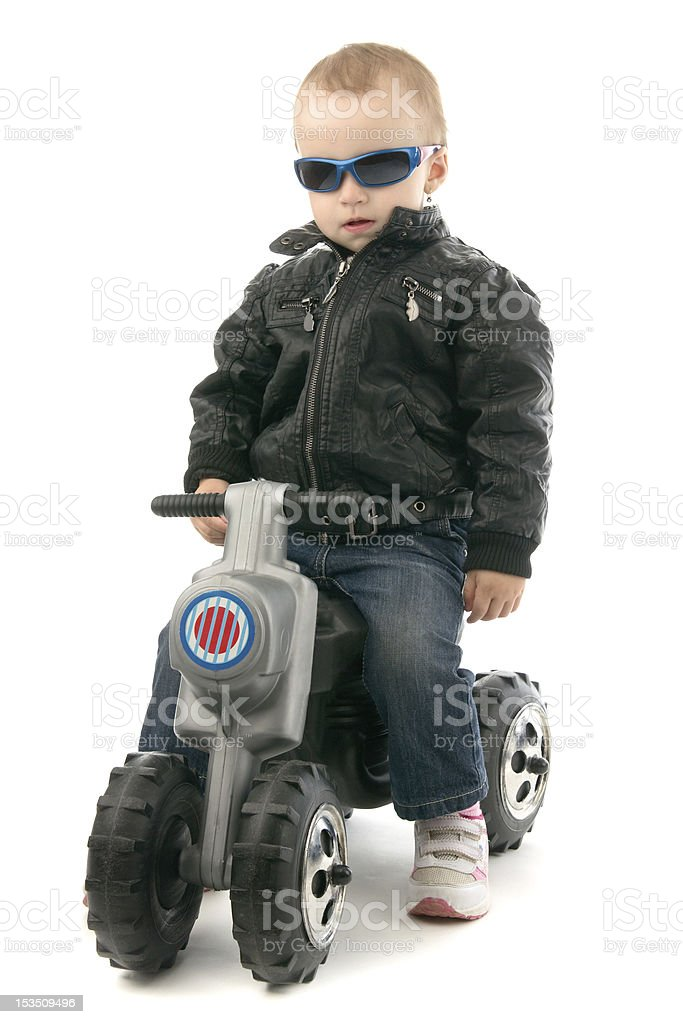 Girl on child's motorcycle royalty-free stock photo