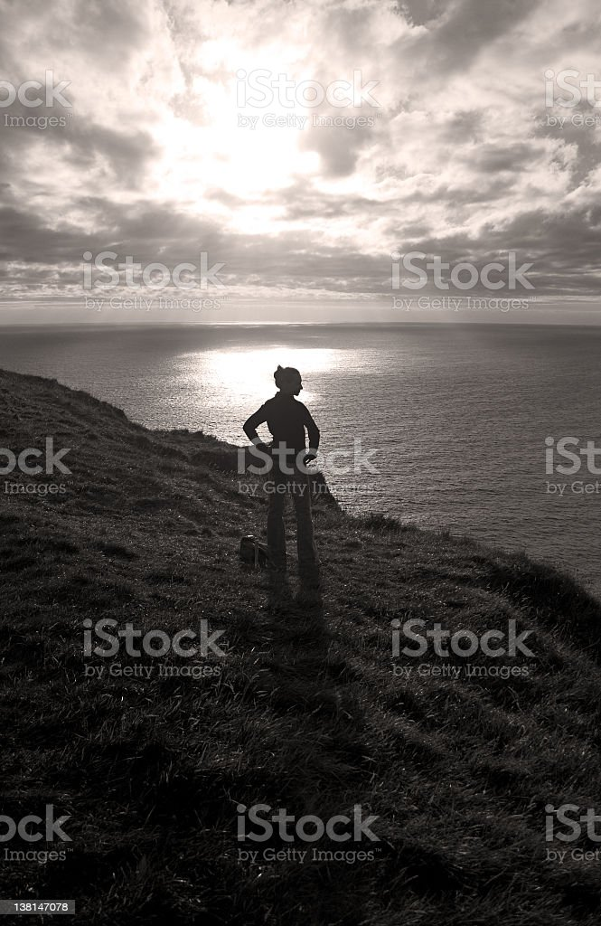 Girl on cliff top stock photo