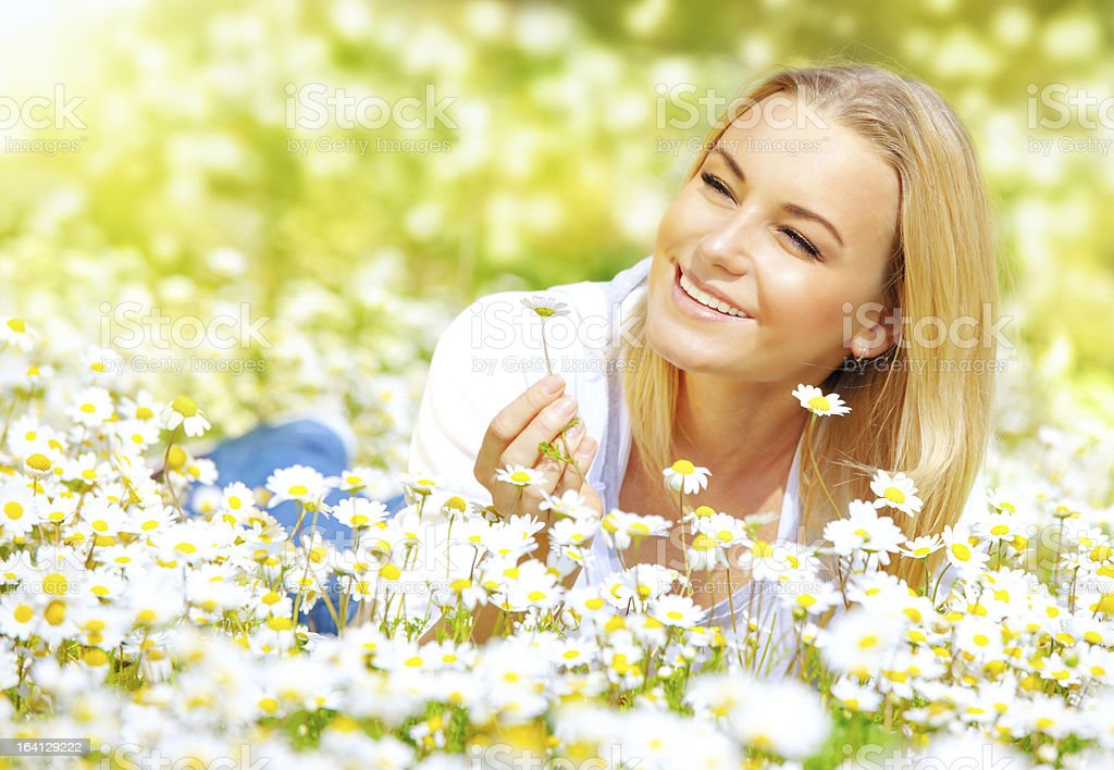 Girl on daisy glade royalty-free stock photo