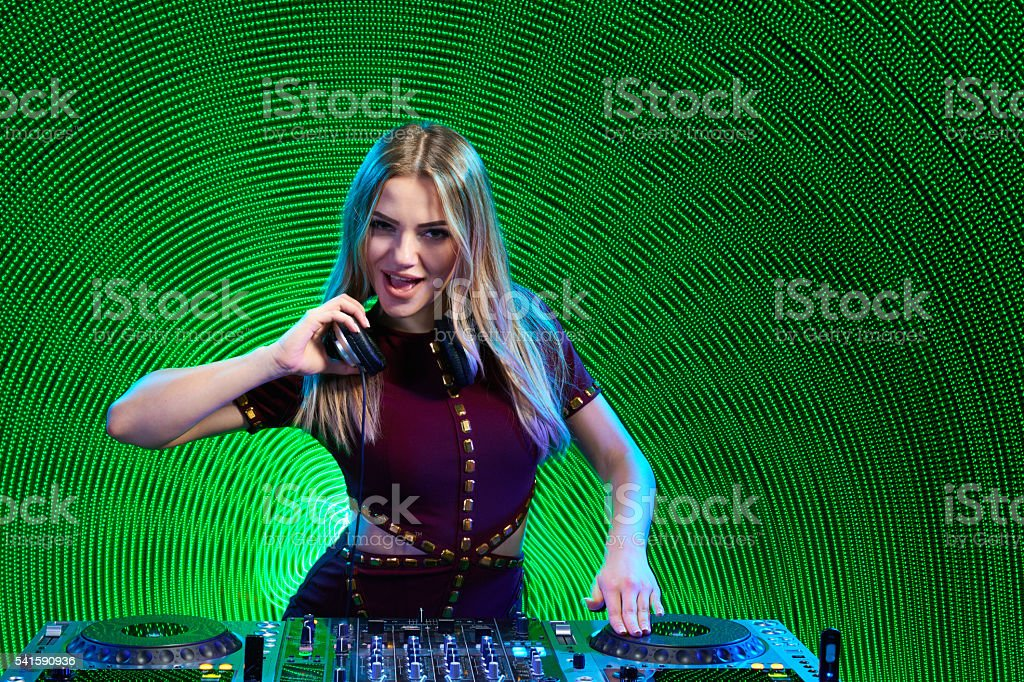 DJ girl on decks at the party stock photo