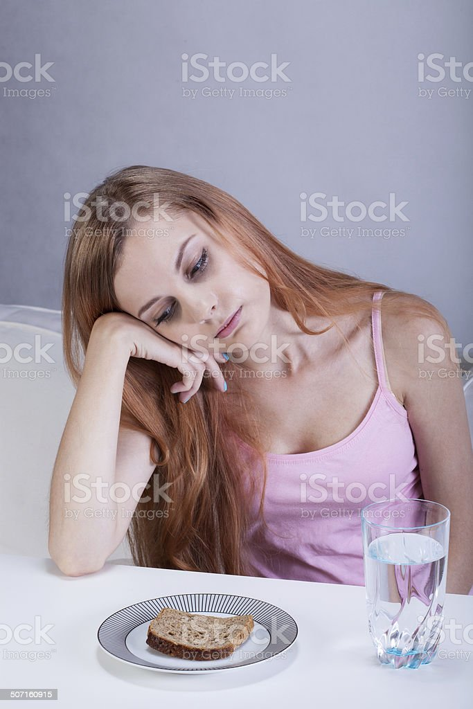 Girl on diet can't eat breakfast stock photo