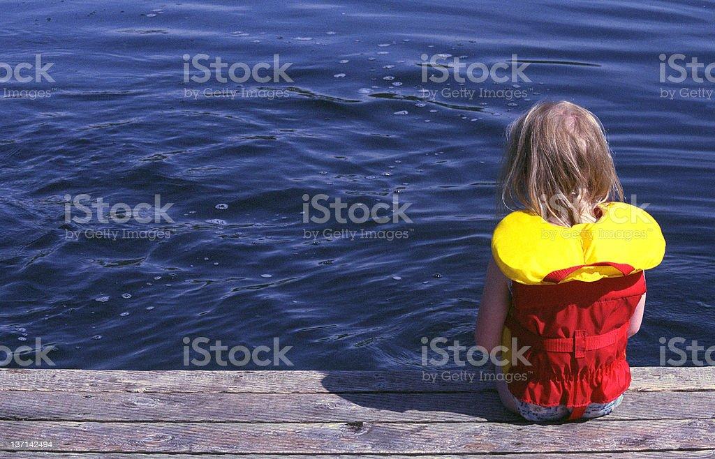 Girl on Dock stock photo