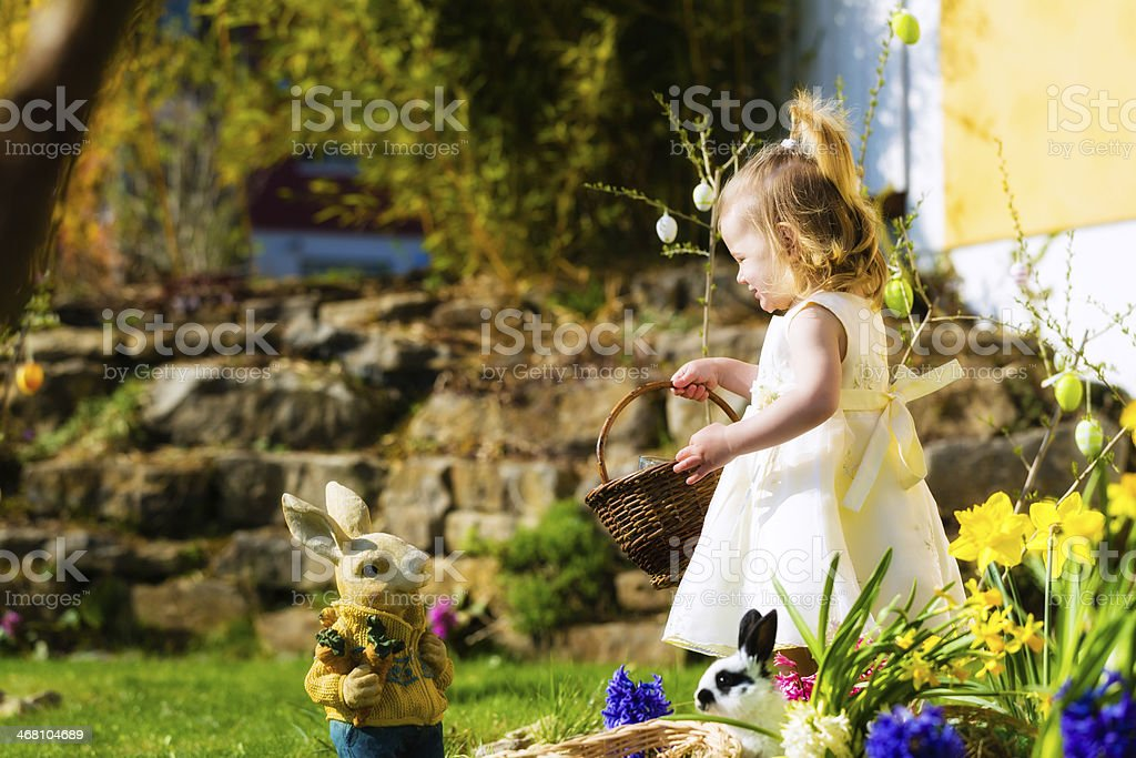 Girl on Easter egg hunt with eggs stock photo