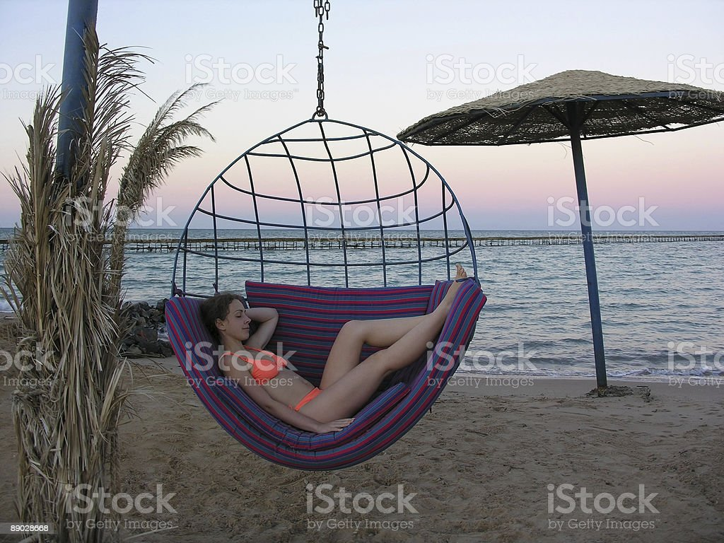 girl on empty evening beach royalty-free stock photo