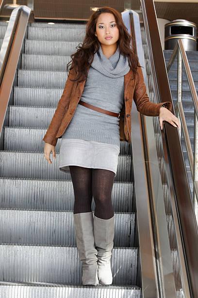 girl on escalator - double_p stockfoto's en -beelden