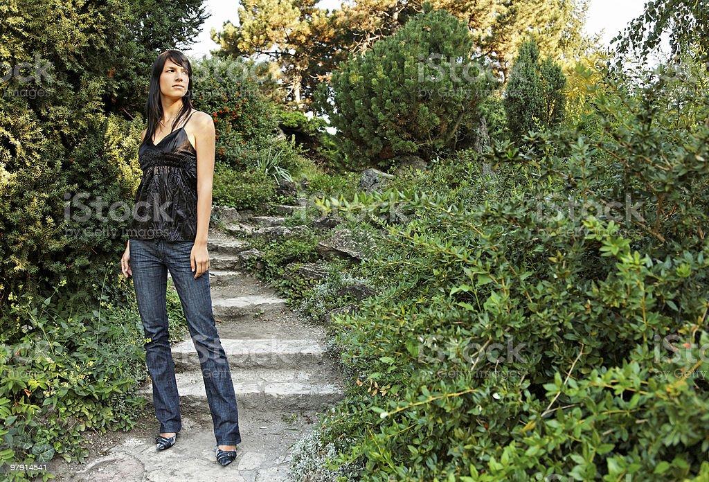 girl on garden steps royalty-free stock photo