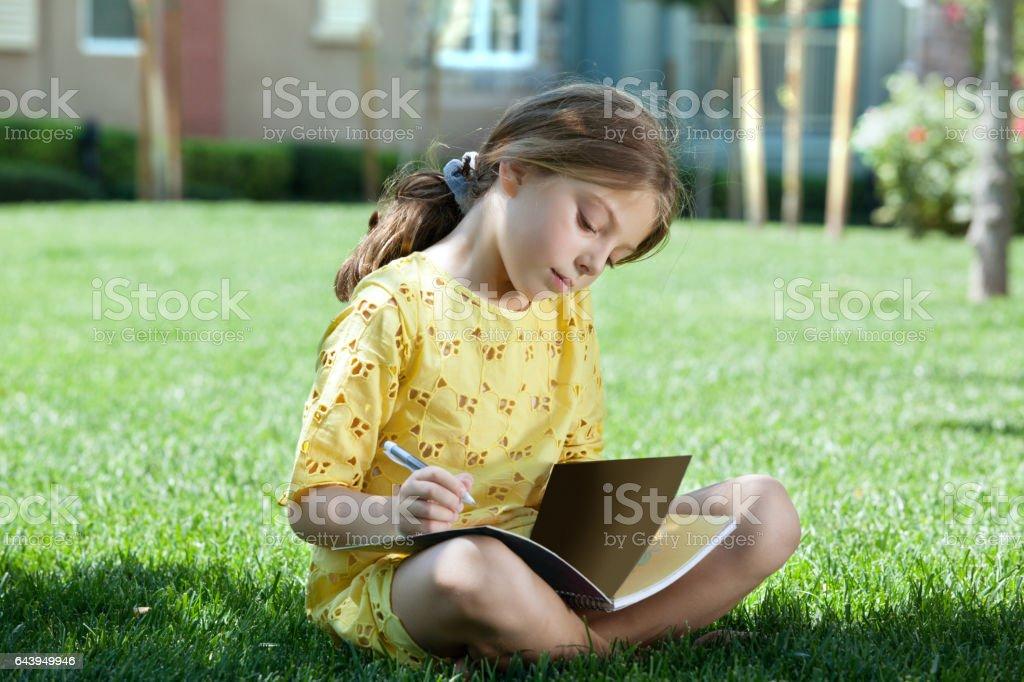 girl on grass stock photo