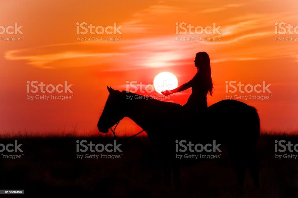 Girl On Horseback At Sunset stock photo