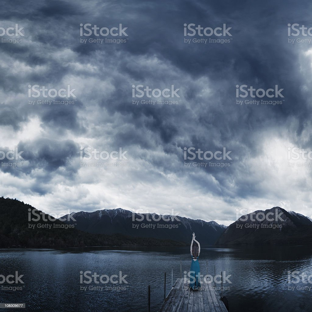Girl on jetty, Rotoiti lake, New Zealand stock photo