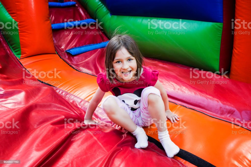 Girl on Jumping Castle stock photo